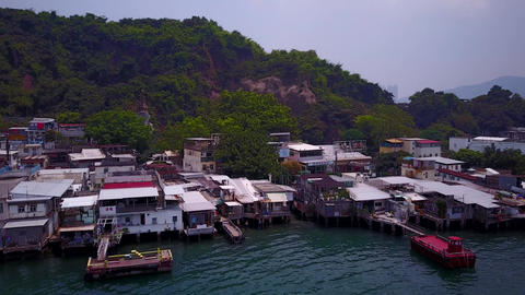 Stilt shanty houses of fishing village at Lei Yue Mun, Hong Kong, tilt down shot Footage