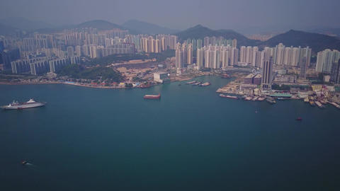 Wide angle aerial panorama of Kwun Tong from Yau Tong, Hong Kong from height Footage