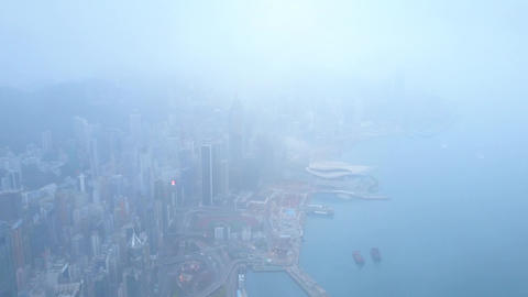Cloudy view of Hong Hong and Victoria Harbour at early morning, aerial panorama Footage