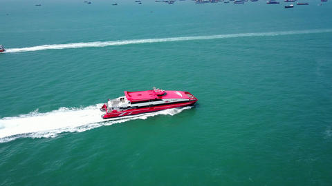 Fast ferry catamaran rush at green water, tracking aerial shot Footage