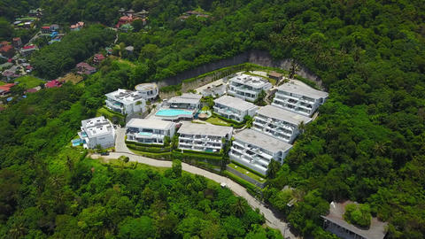 Luxury villas, isolated complex at forested slope of hill, aerial shot Footage