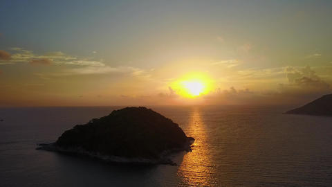 Dark island against beautiful sunset over tropical sea, aerial shot of Koh Mon Footage