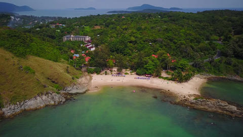 Nice small beach beside tall hill, west shore of Phuket Island, aerial shot Footage