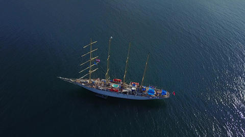 Large elegant sailer ship moored at tropical sea waters, aerial shot Footage