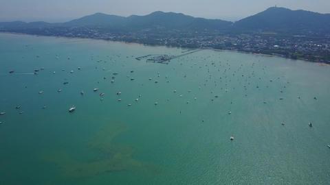 Chalong bay aerial panorama, green sea water, many boats and yachts moored Footage