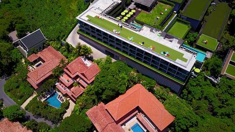 Modern hotel building near with luxury villas, cinematic aerial shot Footage