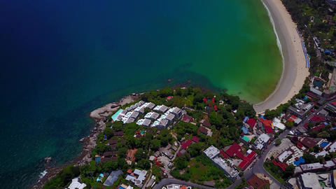 Aerial shot of beautiful Kata beach, tilt up from built foreland Footage