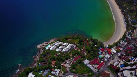Aerial shot of beautiful Kata beach, tilt up from built foreland Footage