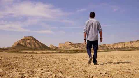 Tracking shot of man entering the desert Desolation Live Action