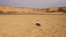 Woman collapsing in the desert Desolation Live Action