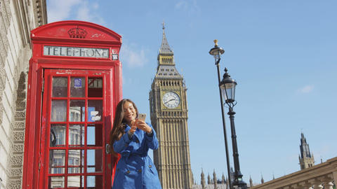 Woman Taking Selfie Against Phonebooth And Big Ben In London England Live Action