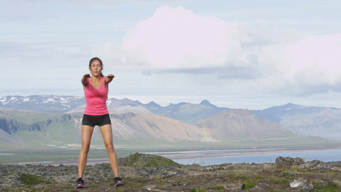 Fitness girl exercising outdoors doing squat - healthy lifestyle woman workout Footage