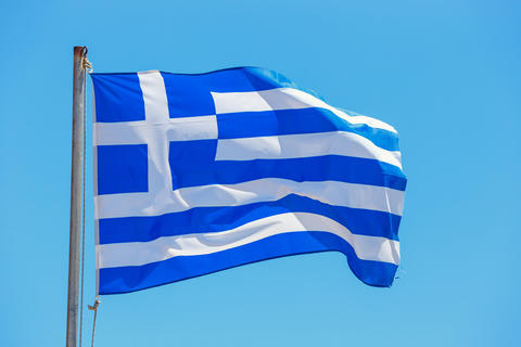 Greek flag on the blue sky background Fotografía