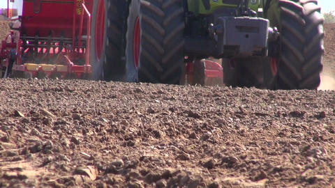 tractor seeding wheat crop seeds on farm field Footage
