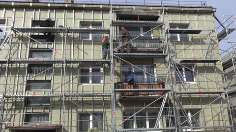 workers fixing thermal insulation material rock wool on house wall Footage