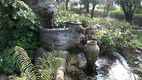 fountain in asia buddhist temple garden park Live Action