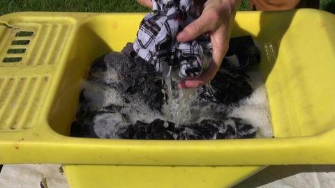 farmer wash clothes Footage