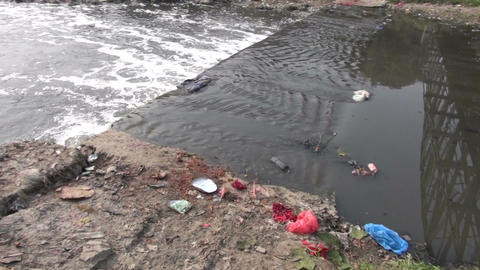 environmental catastrophic pollution in Himalayas. Garbage in sacred river Footage