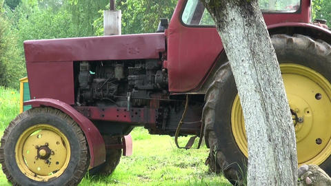 old retro tractor in spring farm garden and beehive Footage