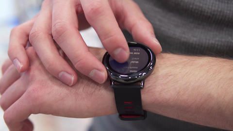 hand touches smart watch Footage