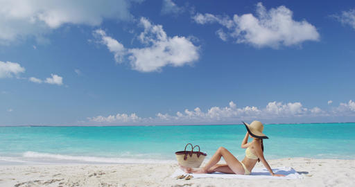 Sexy hat bikini woman sunbathing relaxing on beach Footage