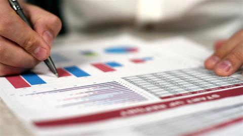 Man Fills Financial Report Footage