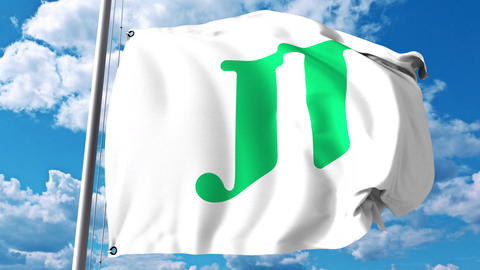 Waving flag with Japan Tobacco JT logo against clouds and sky. 4K editorial Footage
