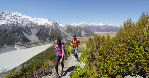Hiking travel people walking in New Zealand in Mount Cook National Park Live Action