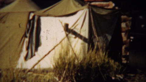 1939: Hunting trip car and canvas style camping tents Footage