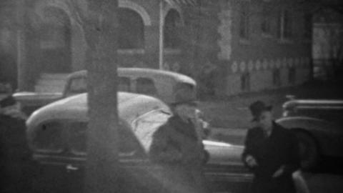 1939: New 2 door coupe style classic car driving residential street Footage