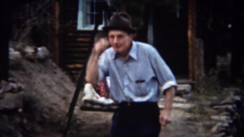 1939: Man wagging finger peek a boo hat takes out denture teeth Footage