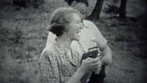 1939: Photographers pointing film cameras at cinematographer Footage