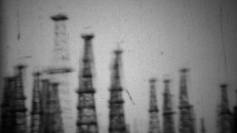 1938: California oil drilling fields steel derrick tower rigging Footage