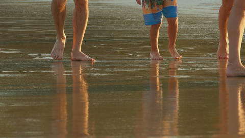Family walking on the beach Footage