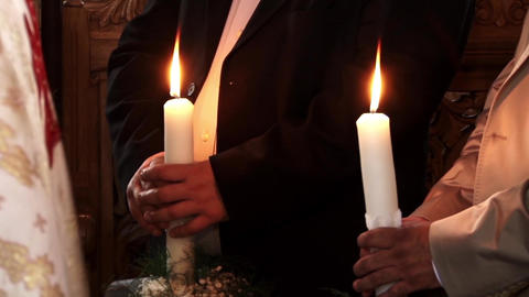 White candles held in hands by participants to religious ceremony 7 Footage