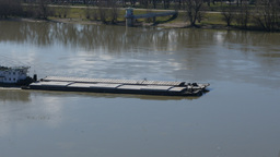 River barge ship passing by on Danube river. Serbia, Novi Sad Footage