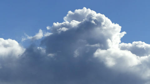 Cumulus clouds time lapse. Fast moving and growing clouds in the sky. Close up Live Action
