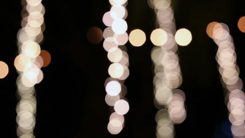 Blurred LED particle lights swaying at night Footage
