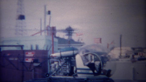 1955: Personal amphibious helicopter taking off from land platform Footage