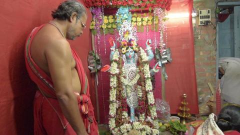 Hindu priest worshipping Goddess Kali Live Action