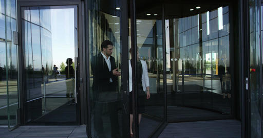 Business people leaving building Footage