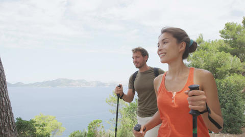 Healthy lifestyle couple hiking in nature forest enjoying hike on Mallorca Live Action