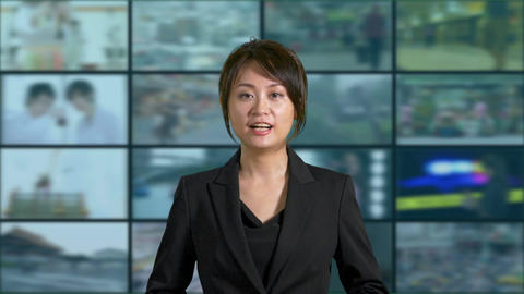 Asian Chinese businesswoman or presenter presenting with tv no mic Footage