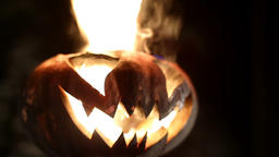 Burning pumpkin on Halloween. Looped GIF