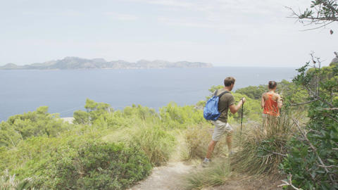 Hiking couple hikers walking in nature Mallorca, Balearic Islands, Spain Footage