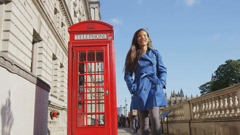 Young Urban Professional Business Woman By Telephone booth and Big Ben In London Footage