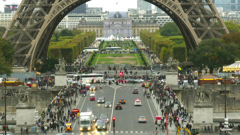 Time lapse of crowded streets near the Eiffel tower base and Champ de Mars in Footage