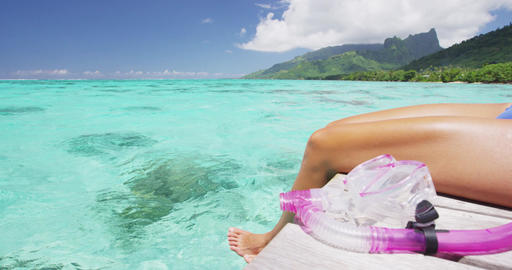 Relaxing swim woman on Tahiti vacation legs in ocean on luxury travel holidays Footage