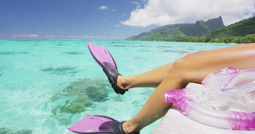 Snorkel swim woman relaxing having fun with fins - legs on tahiti vacation Live Action