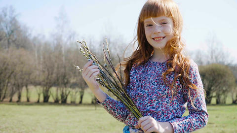Cute ginger girl holding a spring bunch Footage